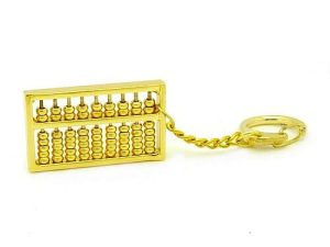 This is an abacus made into a keychain from brass and plated with gold.