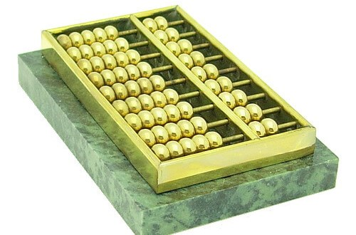 This abacus is made of high-quality brass adhered to a heavy rectangular marble piece.