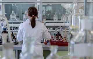 nurse testing urine sample