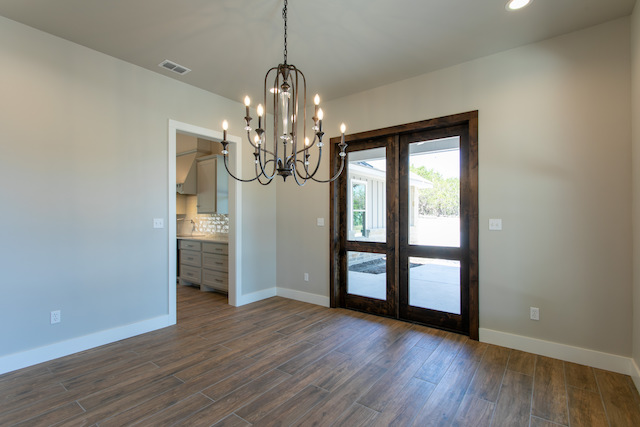 Dining room with wide plank flooring