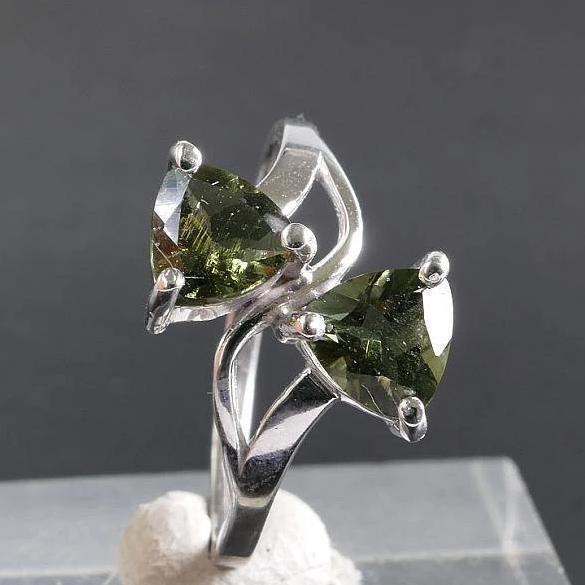Peculiar design due to Its Clepsydra shape for this 925 Sterling Silver ring which has two beautiful faceted Moldavite stones incarnated in itself.