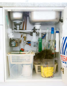"What a simple idea that makes use of every inch of cabinet space! Install a tension rod to hang spray cleaners to free up the ""floor space"" in the cabinet. Genius! Via A Thousand Words"