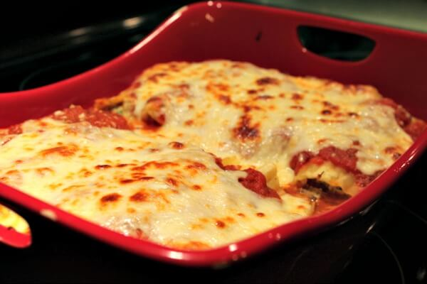 Want all the lasagna flavor without lasagna effort? Try this beef and ricotta stuffed manicotti recipe topped with homemade sauce and melted mozzarella.