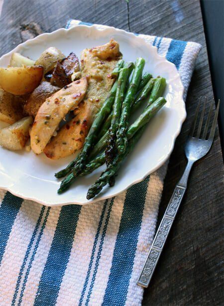 Hey, this one is easy! One Pan Chicken Dinner with roasted potatoes and asparagus. Delicious, filling, and fast clean-up. Cook like a rock star.