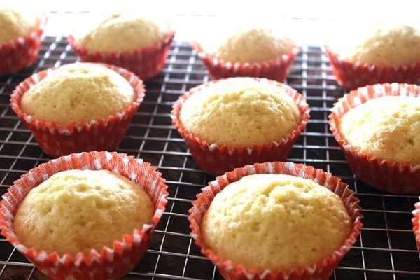 When you peel away the paper and take that first bite...that is one of life's perfect moments. Orange Marmalade Cupcakes with Orange Frosting are amazing!