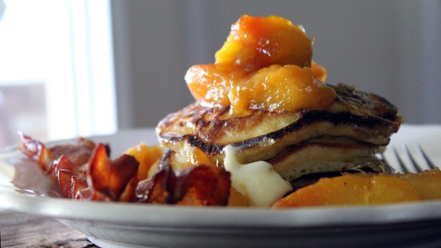 Fresh peaches are the star of this breakfast recipe for Peach Buttermilk Pancakes. Oh, and don't skip on our Butter Brown Sugar Topping! buythiscookthat.com/peach-buttermilk-pancakes/ #breakfast #recipe