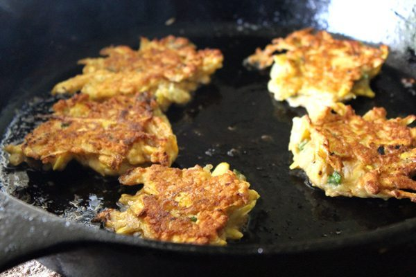 Our new favorite way to eat summer squash-Squash Cakes. These are good. Really good. Fresh yellow squash, cooked in batter to savory-sweet fried goodness.