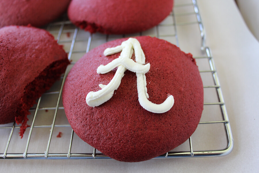 """A red velvet whoopie pie decorated with the Alabama """"A"""" logo"""