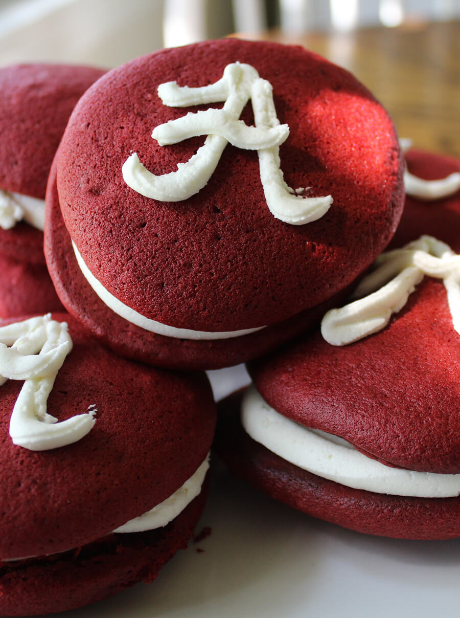 Alabama football is a pretty big deal. And so are Big Al's Red Velvet Whoopie Pies. With only 6 ingredients, these are a fun way to celebrate your next Alabama Tailgate. Crimson velvet cake sandwiches filled with sweet buttercream frosting are the perfect dessert treat for Saturday in the South. Roll Pie!
