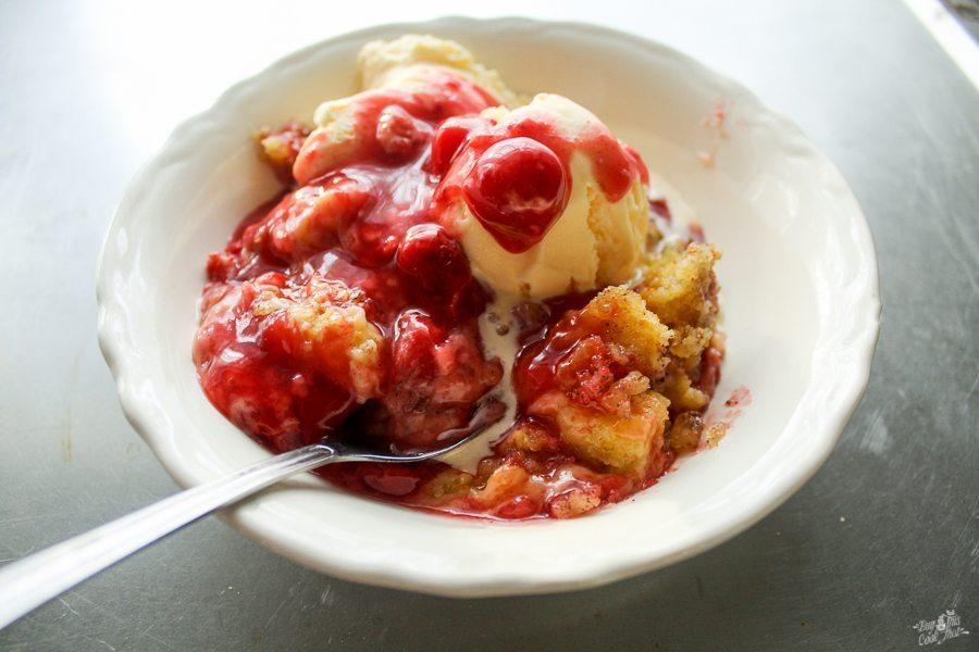 Cinnamon Cherry Crockpot Cobbler served with vanilla ice cream