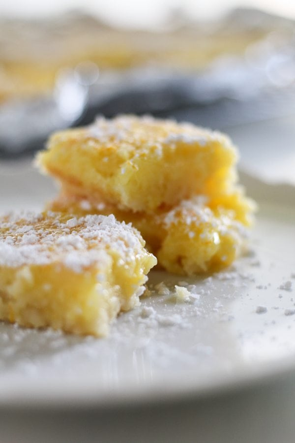 Citrus Orange Lemon Bars on a plate, dusted with powdered sugar