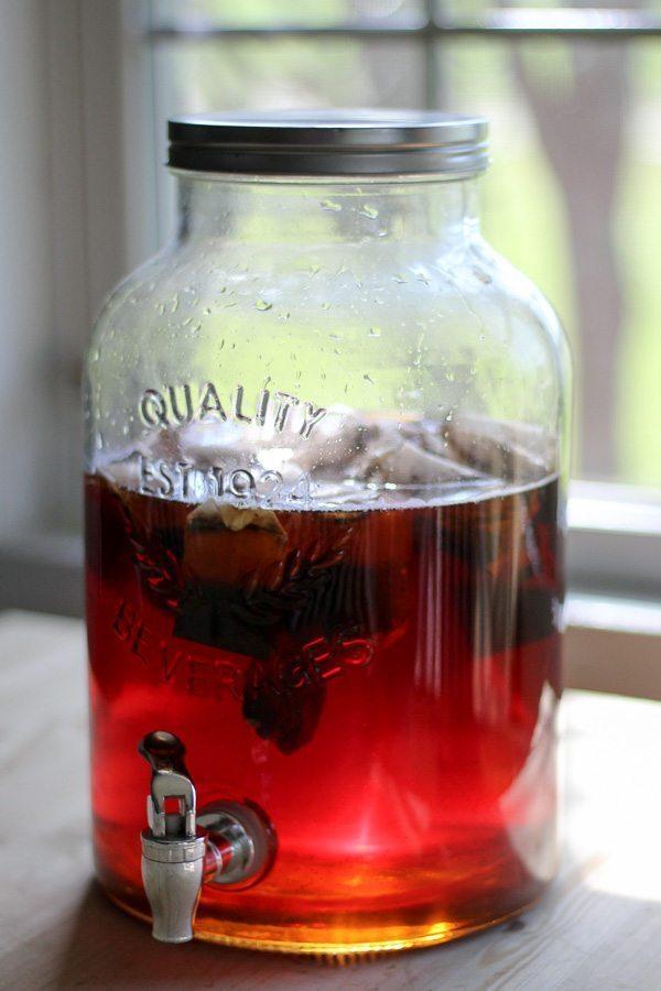 Sunlight shining through a glass jug of sun tea