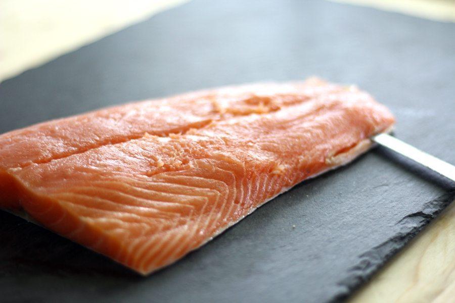 A fresh salmon filet on a slate board