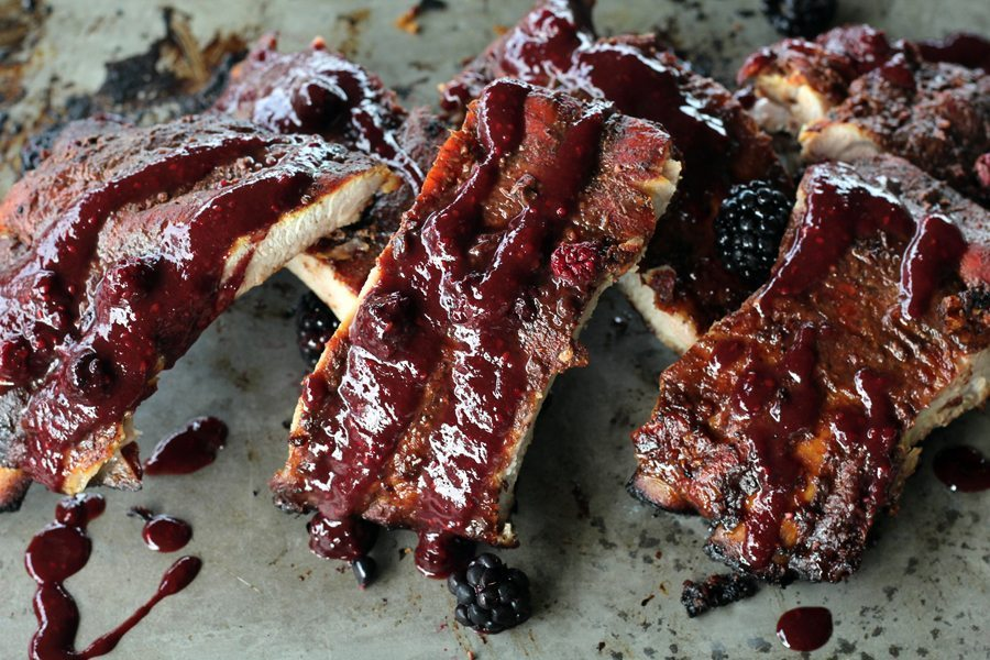 Pork ribs on a tray with wild blackberry barbecue sauce