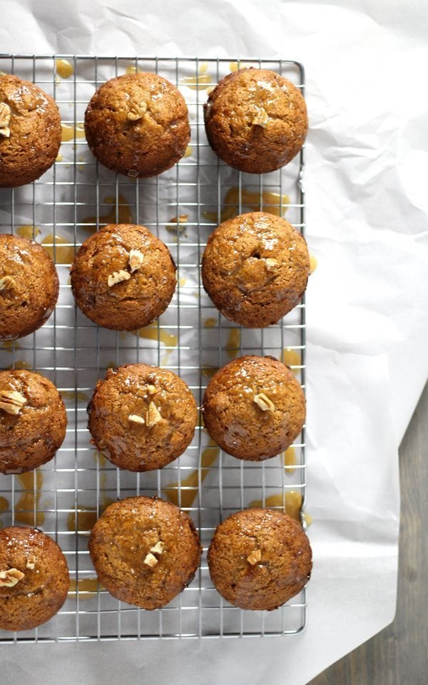 Warm pumpkin muffins on a wire cooling rack