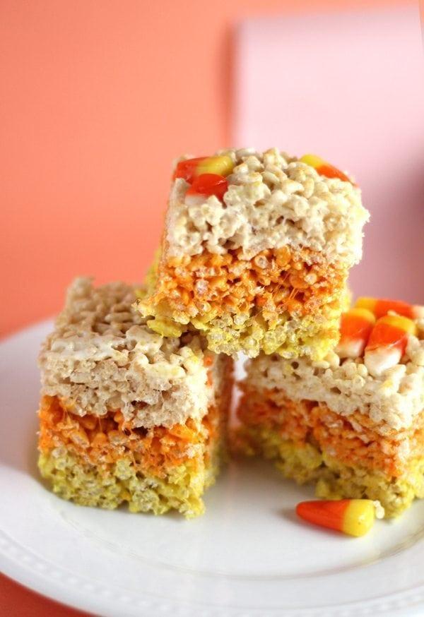 Three Candy Corn Rice Krispie Treats on a plate.