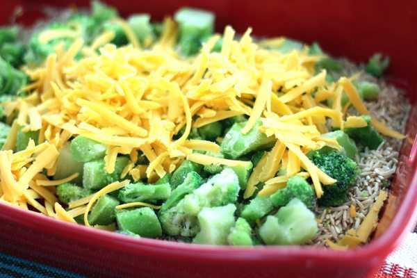 Rice and broccoli covered with shredded cheese
