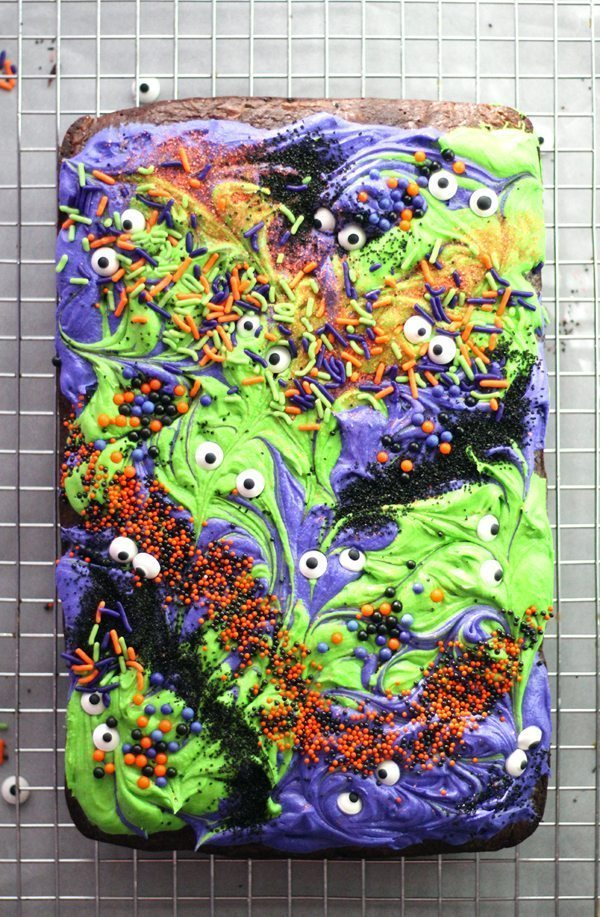 Halloween brownies swirled with frosting and sprinkles, cooling on a wire rack
