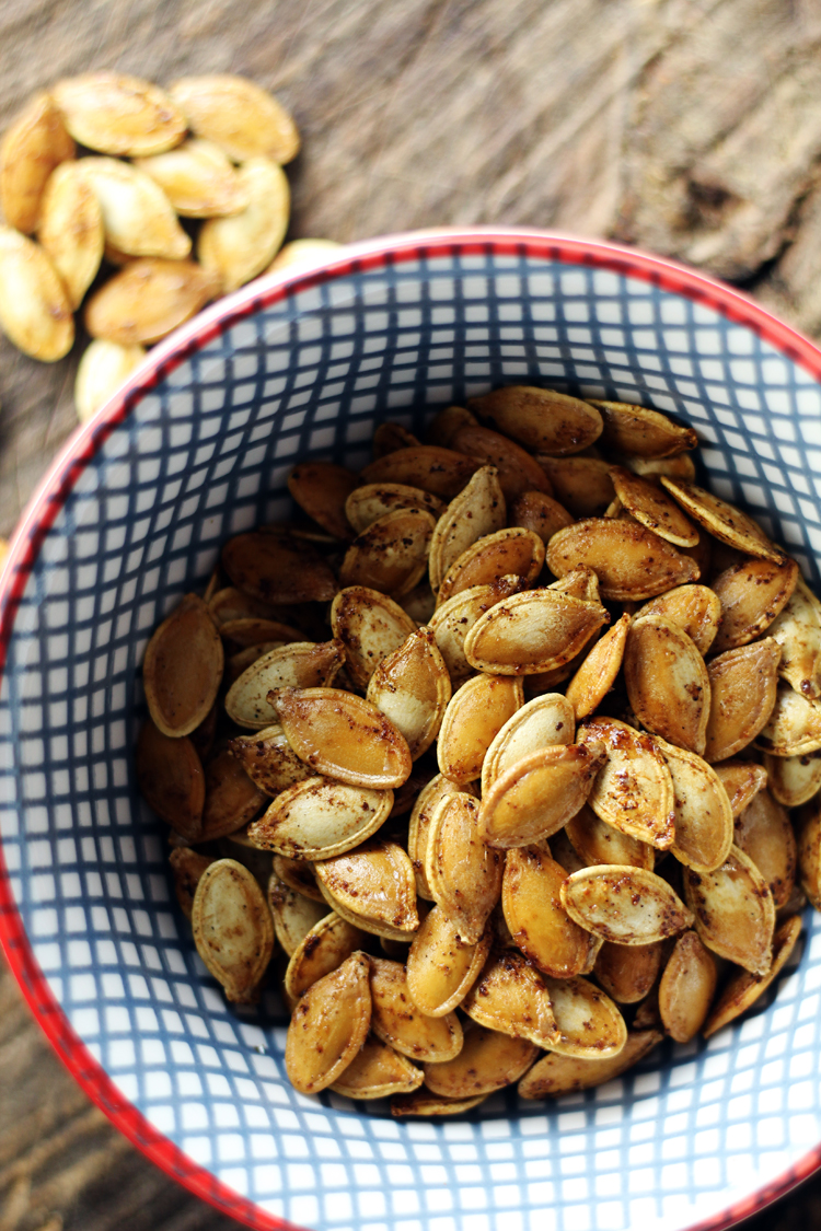 A bowl filled with roasted pumpkin seeds