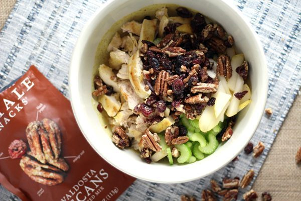 A bowl of chicken salad with tender chicken, pecan mix, fresh celery and pears