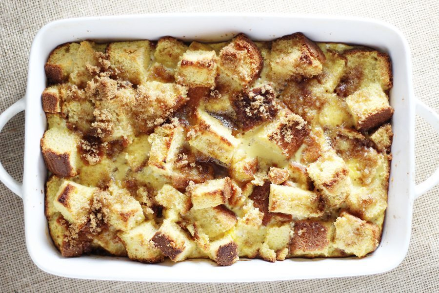 A white baking dish with warm bread pudding