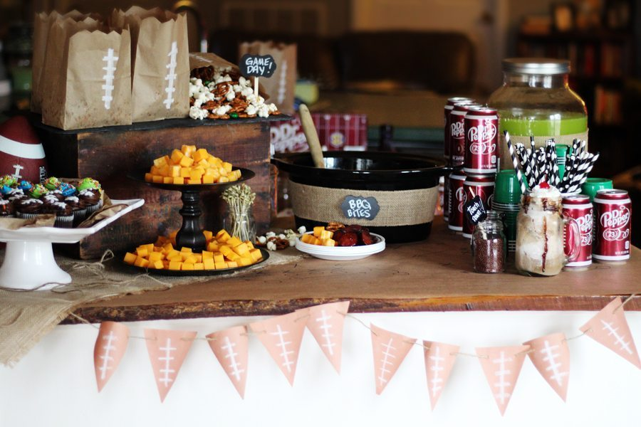 A table set up for a football party with snacks and drinks