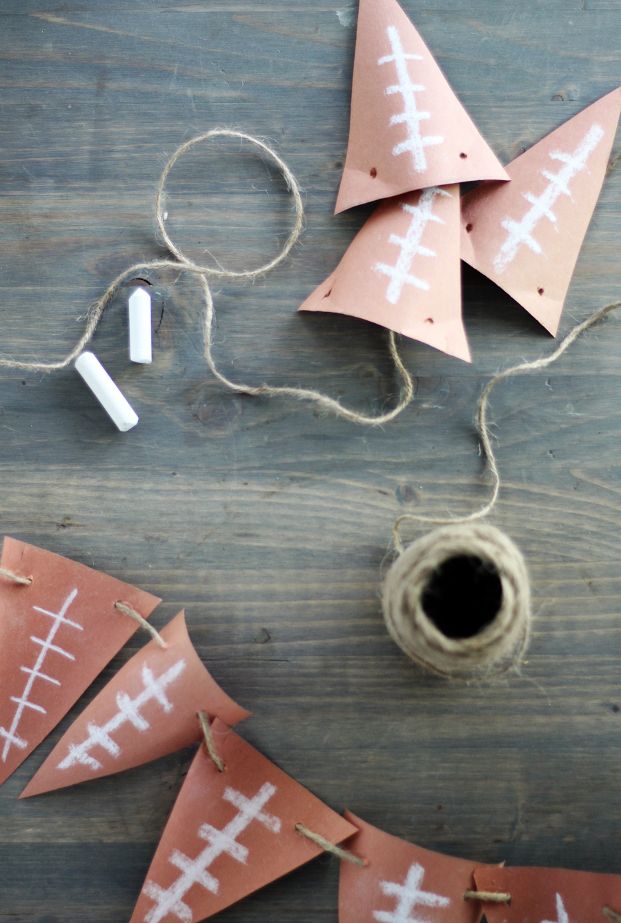 Only have a few minutes and need a last minute touch for your gameday party? Make this fast + easy football banner for pennies.