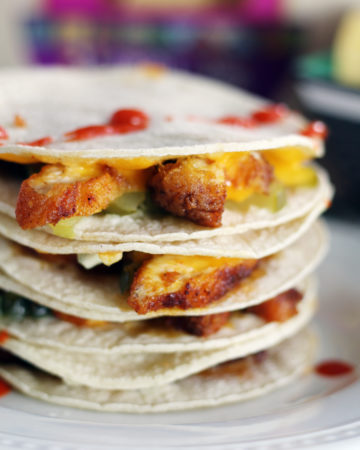 Topped with sharp cheddar, dill pickles and a little blue cheese, these Nashville Hot Chicken Quesadillas are amazing.