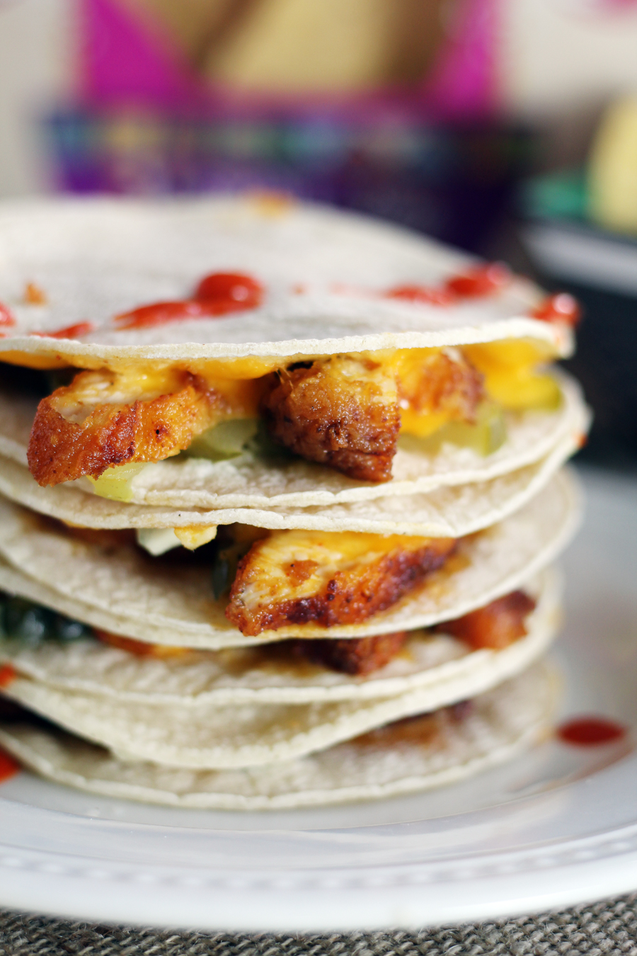 Corn tortillas topped with hot chicken, pickles, cheese and more