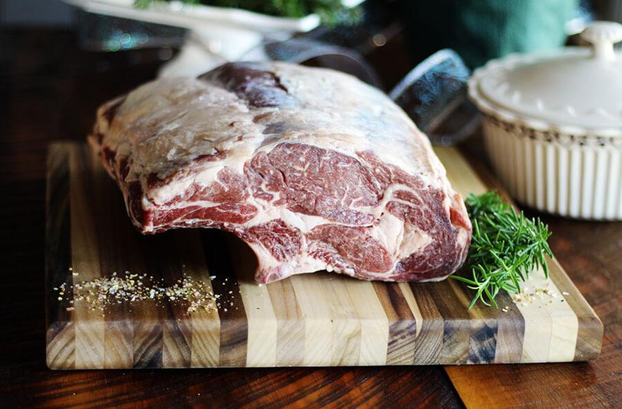 A beautiful prime rib roast on a cutting board