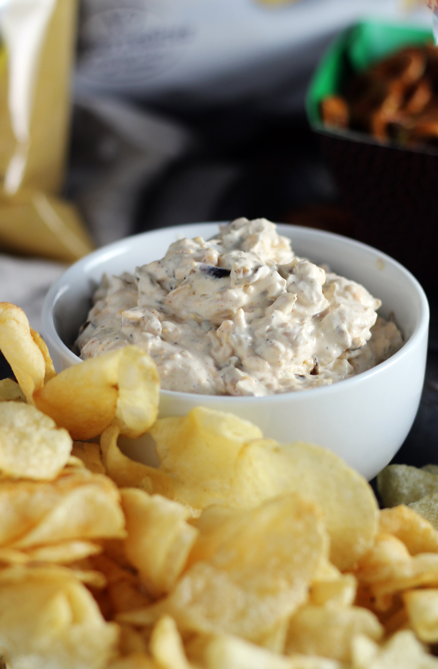 a bowl of french onion dip with kettle cooked chips