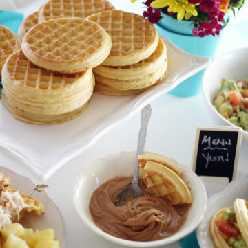 A picture of a white platter with stacks of waffles