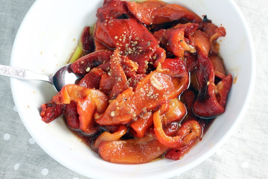 A bowl of red bell peppers, roasted and marinated