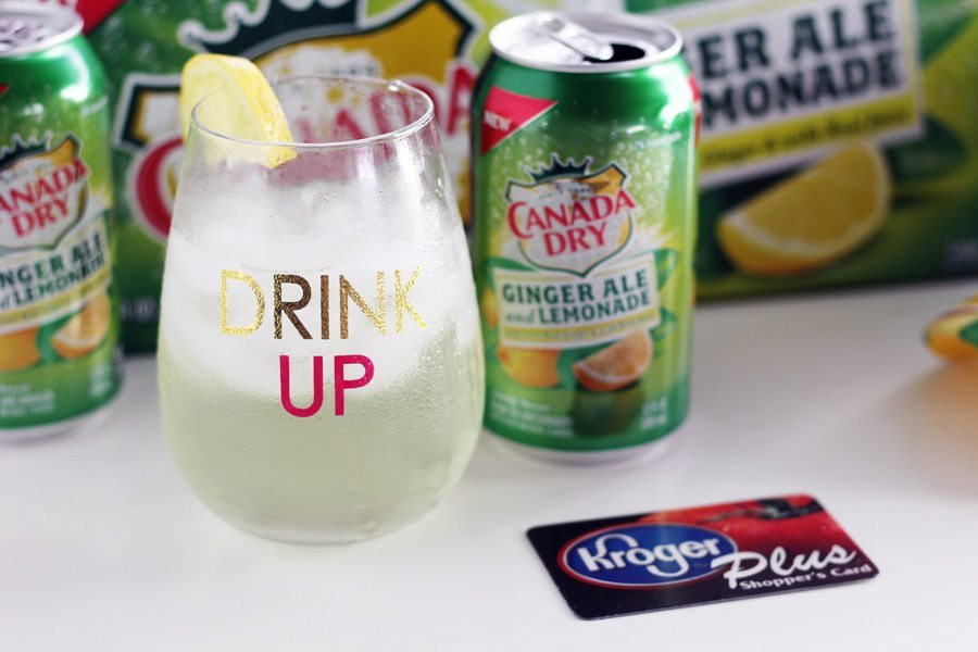 Ginger Ale can next to a glass of ginger ale over ice