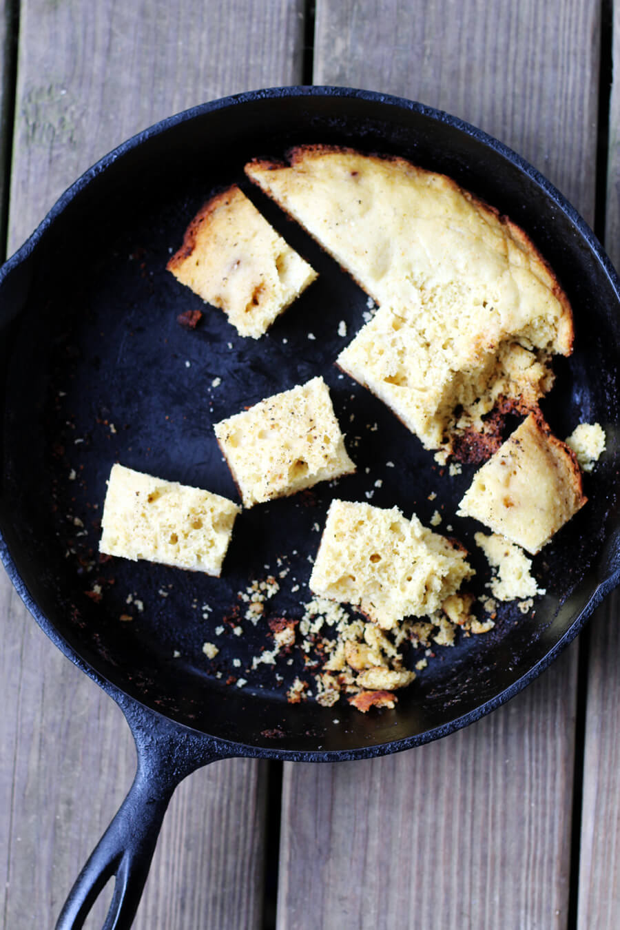 An overhead shot of a cast iron skillet cornbread