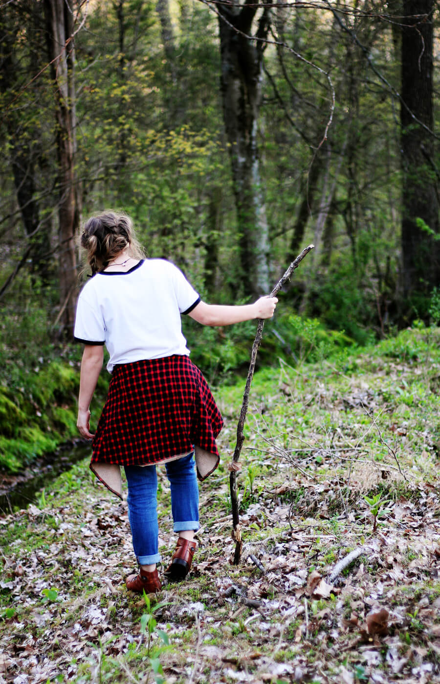 A picture of a young girl hiking through the woods