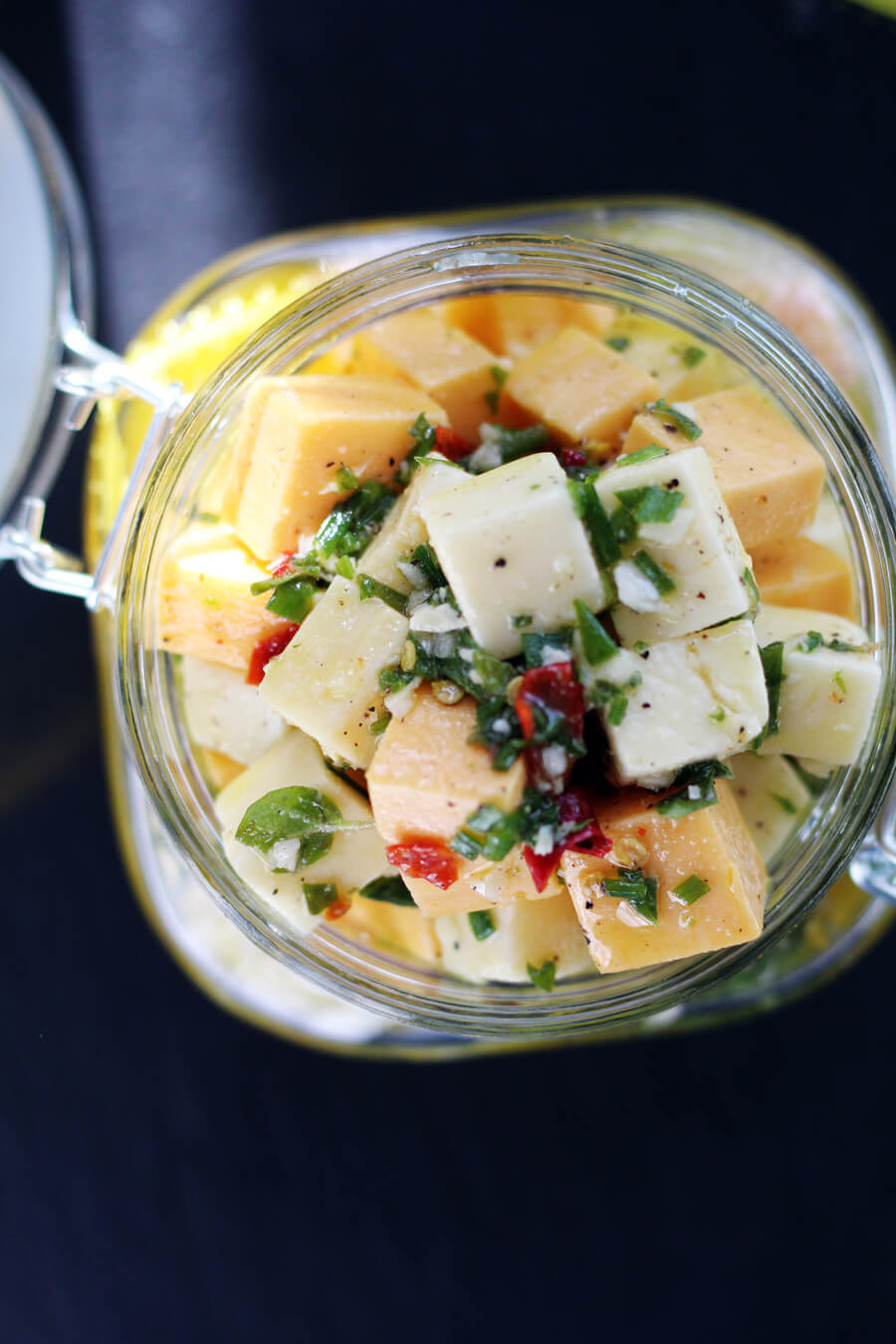 An overhead close up view of the cheddar cheese appetizer in a gift jar