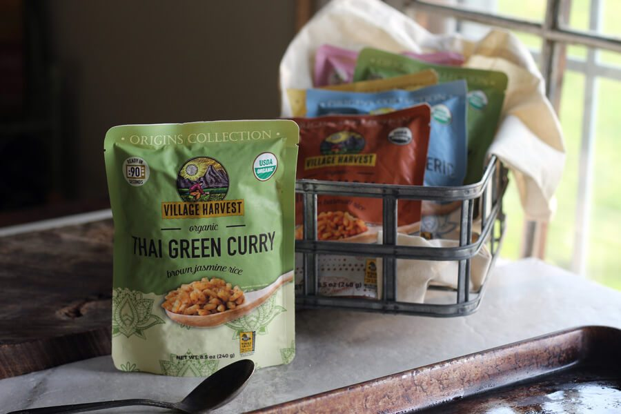 A selection of ready-made rice varieties from Village Rice, featuring Thai Green Curry brown jasmine rice