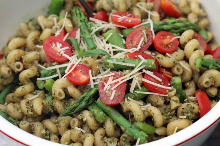 A close up shot of a bowl of Pesto Pasta Salad