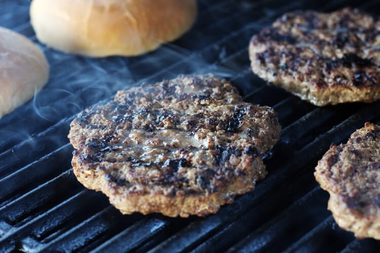 Grilled hamburger patties and buns