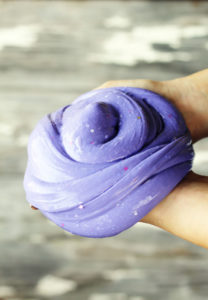 A large bundle of purple slime with glitter in it