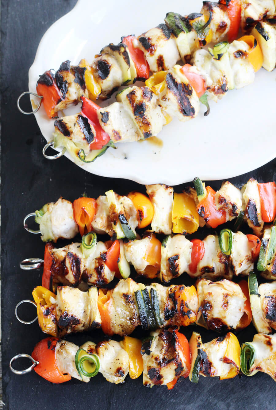 You are going to love this easy recipe for grilled Marinated Chicken Skewers with fresh veggies. You won't believe how simple and delicious it is to get tender grilled chicken using our tangy marinade recipe. We have a little trick up our sleeves. No worries, it is a yummy one.