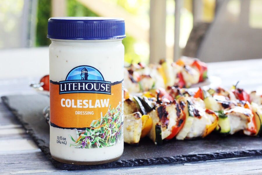 A jar of Litehouse dressing with chicken skewers in the background