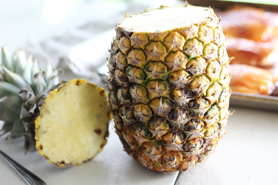 a fresh, ripe pineapple with the top cut off