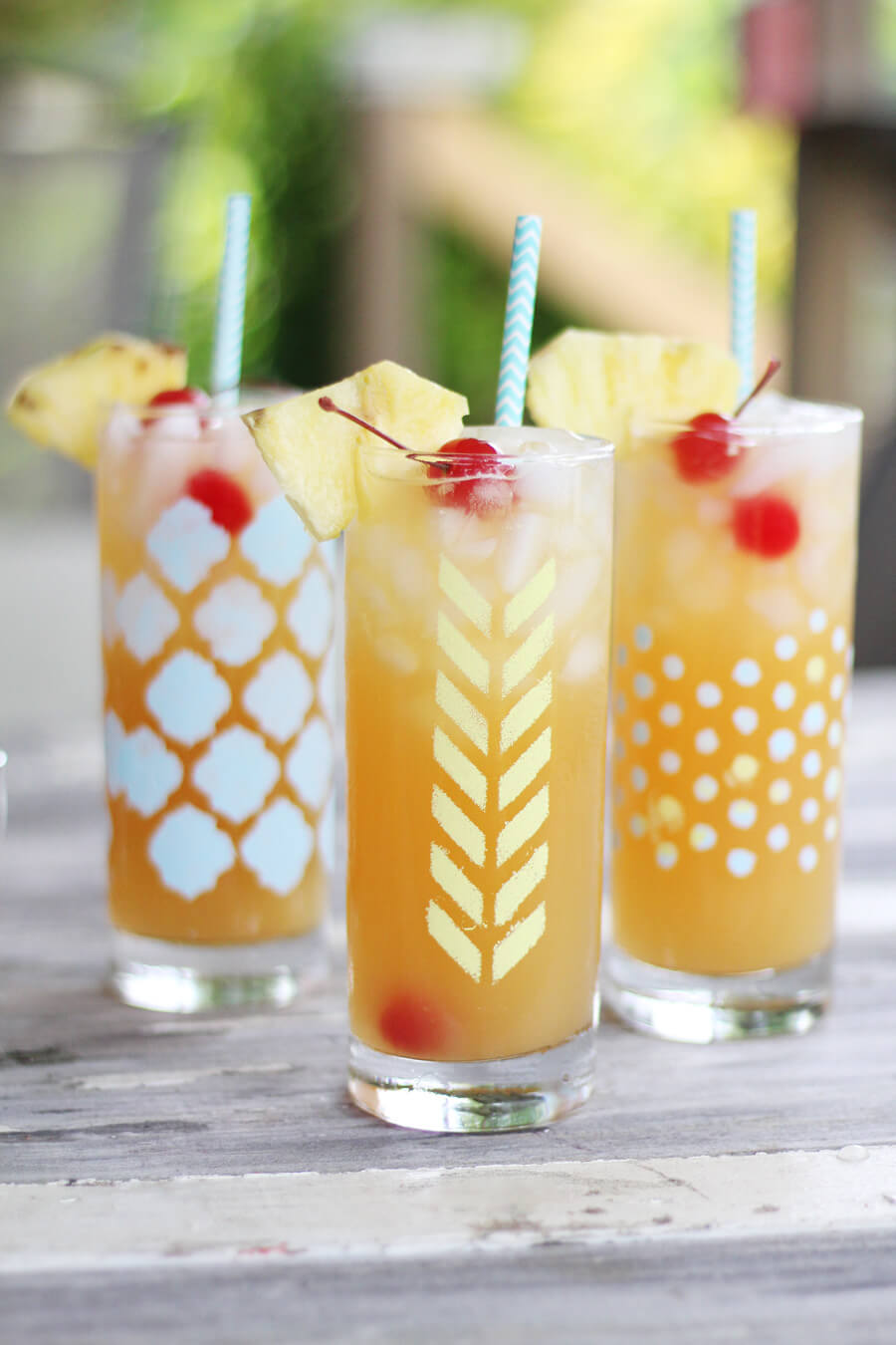 Three cocktail glasses with refreshing tropical lemonade