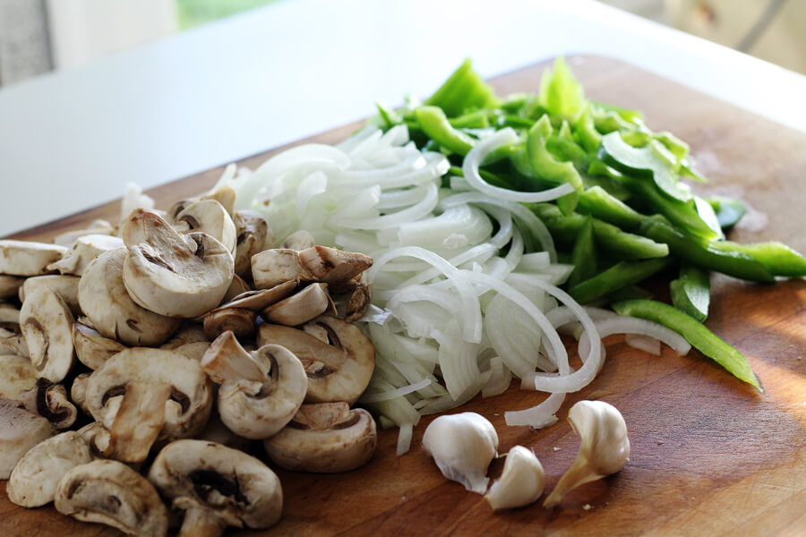 sliced fresh onions, green bell peppers, and mushrooms