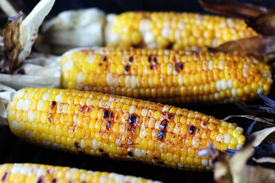 prepared corn on the cob with a spicy butter mixture