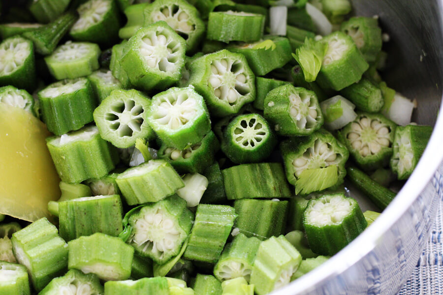 Chopped okra, celery and onion in a pan
