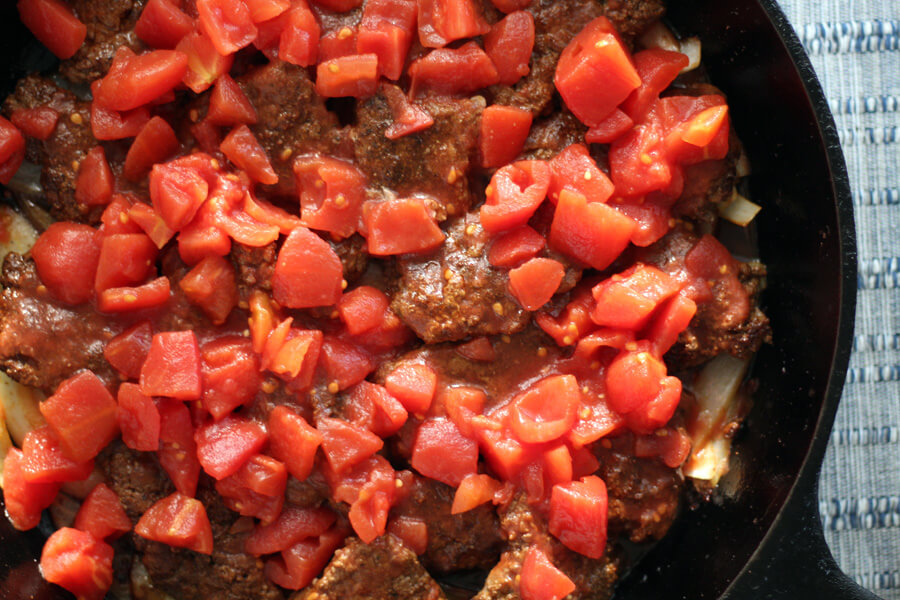 seasoned browned steak topped with hearty stewed tomatoes