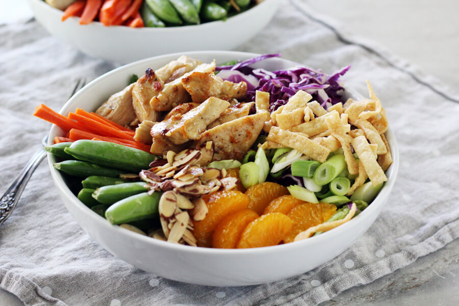 Full of wow-flavor and crunch, this Mandarin Chinese Chicken Salad is loaded with healthy veggies, marinated chicken and topped with homemage ginger dressing.